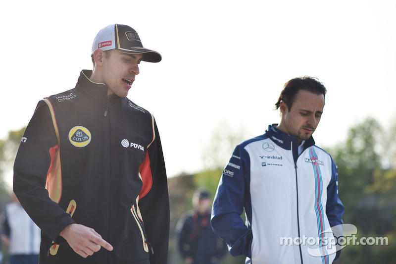 Pastor Maldonado, Lotus F1 Team bersama Felipe Massa, Williams