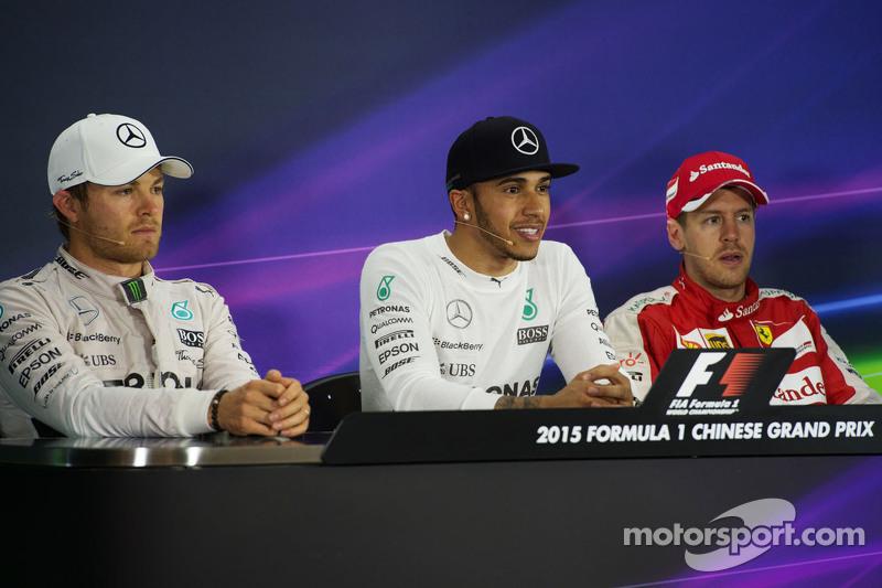 Konferensi Pers FIA pasca-balapan: Nico Rosberg Mercedes AMG F1, second; Lewis Hamilton Mercedes AMG F1, race winner; Sebastian Vettel Ferrari, third