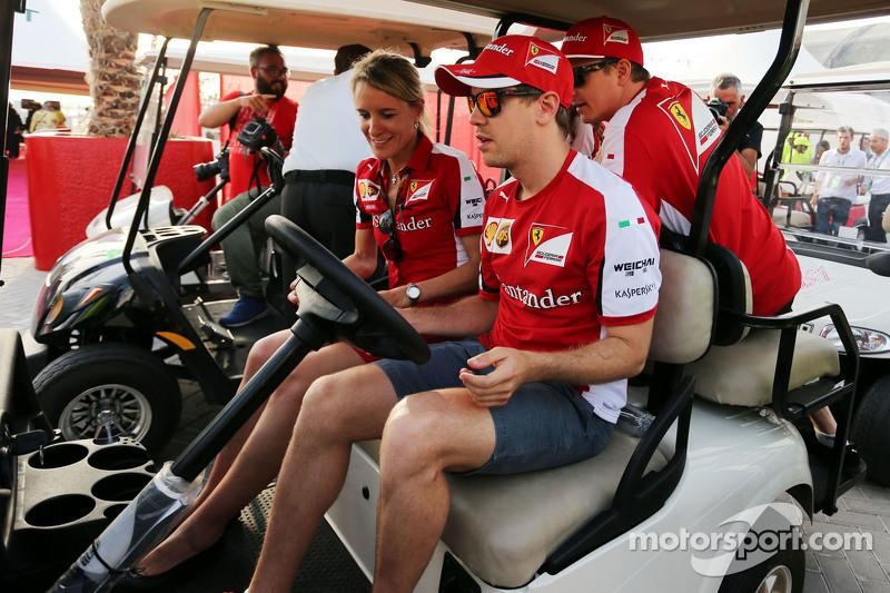 Sebastian Vettel, Ferrari drives a golf buggy bersama Kimi Raikkonen, Ferrari, dan Britta Roeske, Ferrari Press Officer