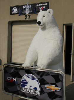 A polar bear watches over the garage area