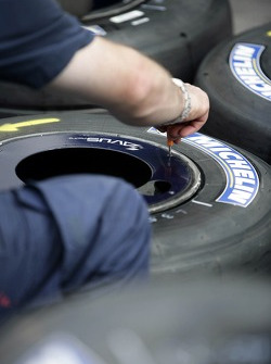 A Red Bull Racing crew member with Michelin tyres