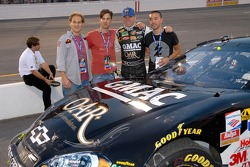 Brian Vickers stands with band members OAR