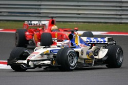 Jenson Button leads Felipe Massa