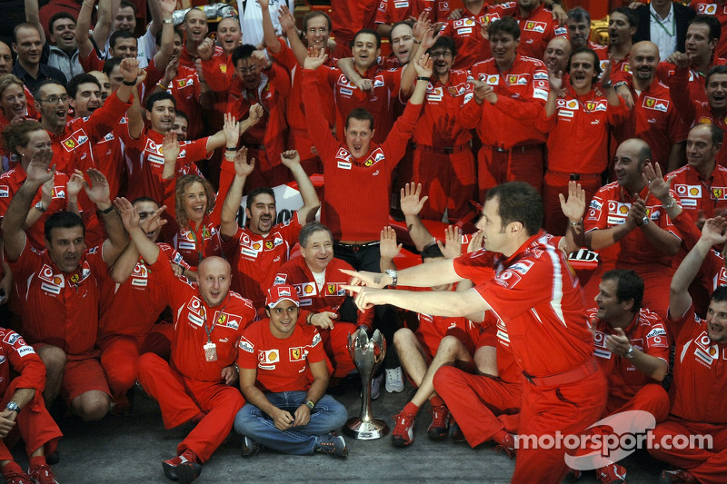 Race winner Michael Schumacher celebrates with Ferrari team members