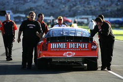 Home Depot Chevy crew members push the car to the starting grid