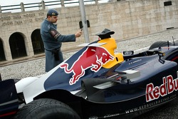 Red Bull Racing demo run in Sao Paulo: the RB2 of Michael Ammermuller photograped by a policeman