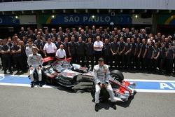 McLaren Mercedes team photo: Kimi Raikkonen and Pedro de la Rosa pose with McLaren Mercedes team members