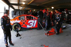 Cingular Wireless Chevy vrew members work on Jeff Burton's car in the garage after having engine problems