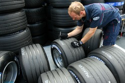 Red Bull Racing crew member marks Michelin tyres