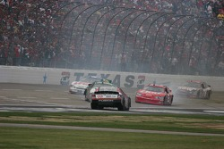 Dale Earnhardt Jr. tries to avoid a spinning Mark Martin