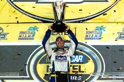 Championship victory lane: 2006 NASCAR Nextel Cup champion Jimmie Johnson hoist the Nextel Cup