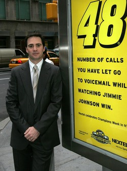 Jimmie Johnson poses by a Sprint Nextel ad next to the Waldorf-Astoria in New York City