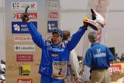 Bike category podium: Winner Cyril Despres celebrates