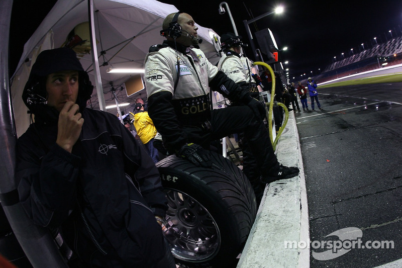 Exchange Traded Gold AIM Autosport crew members wait for a pitstop