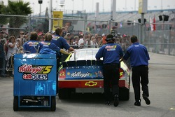Kyle Busch is pushed to pitlane