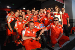 Race winner Casey Stoner celebrates with Ducati team members