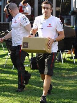 Fernando Alonso, McLaren Mercedes, carrying a box