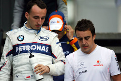 Robert Kubica,  BMW Sauber F1 Team and Fernando Alonso, McLaren Mercedes