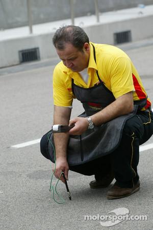 Pirelli technician takes track temperature
