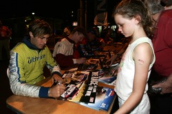 Drivers signing autographs