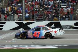 Jon Wood's damaged car returns to the race