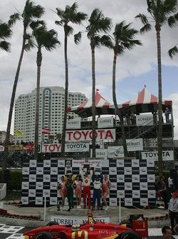 Podium: race winner Sébastien Bourdais celebrates with Oriol Servia and Will Power