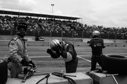 PKV Racing crew members react as Tristan Gommendy runs out of fuel while in the lead