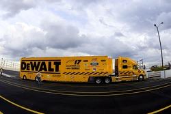 The DeWalt Ford team hauler enters the track