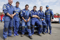 Chris Atkinson and Stéphane Prévot with Subaru WRT team members