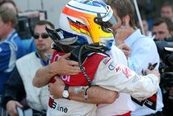 Dr. Wolfgang Ullrich, Audi's Head of Sport, congratulates Mike Rockenfeller, Audi Sport Team Rosberg