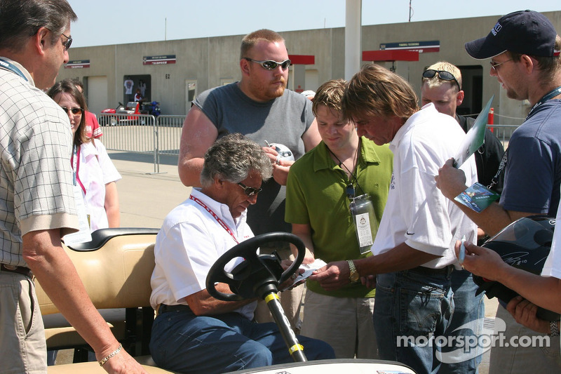 Mario Andretti signs autographs for fans