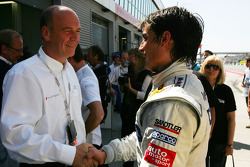 Dr Wolfgang Ullrich, Audi's Head of Sport congratulates Bruno Spengler, Team HWA AMG Mercedes, with pole position