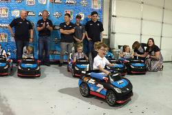 Go Baby Go sponsor event at Tommy Baldwin Racing