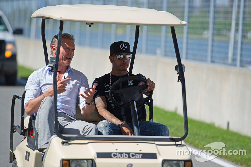 Lewis Hamilton, Mercedes AMG F1 drives the circuit with David Coulthard, Red Bull Racing and Scuderia Toro Advisor / BBC Television Commentator
