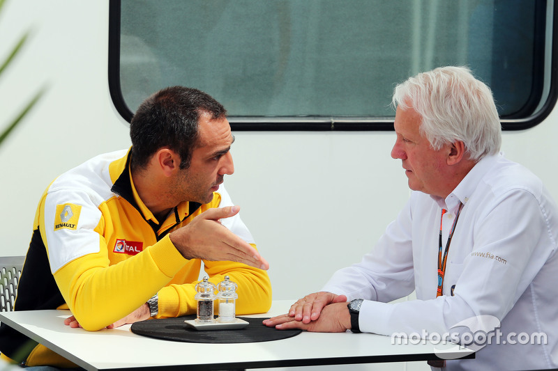 Cyril Abiteboul, Renault Sport F1 Managing Director with Charlie Whiting, FIA Delegate