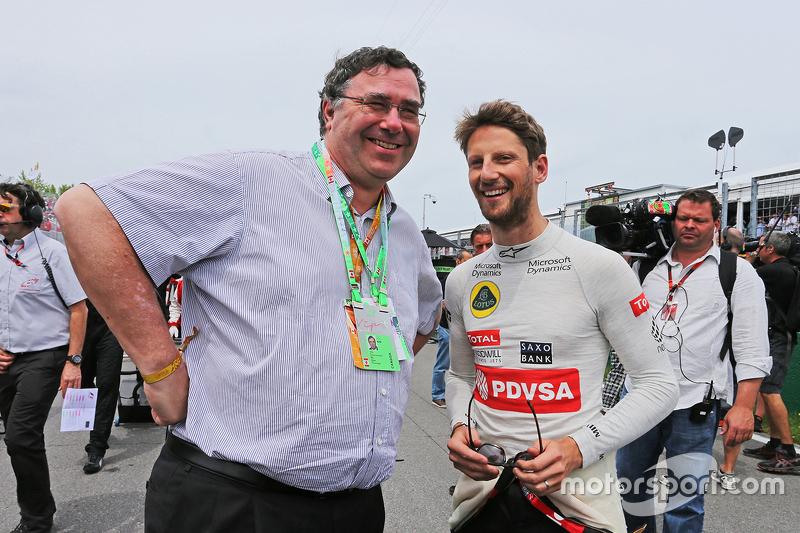 Патрік Пуйен, Президент та CEO Total SA, з Ромен Грожан, Lotus F1 Team на стартовій решітці