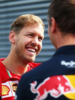 Sebastian Vettel, Ferrari with Ole Schack, Red Bull Racing Mechanic