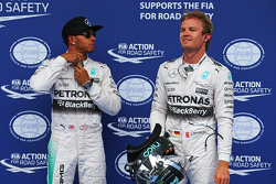 Pole sitter Lewis Hamilton, Mercedes AMG F1 with second placed Nico Rosberg, Mercedes AMG F1