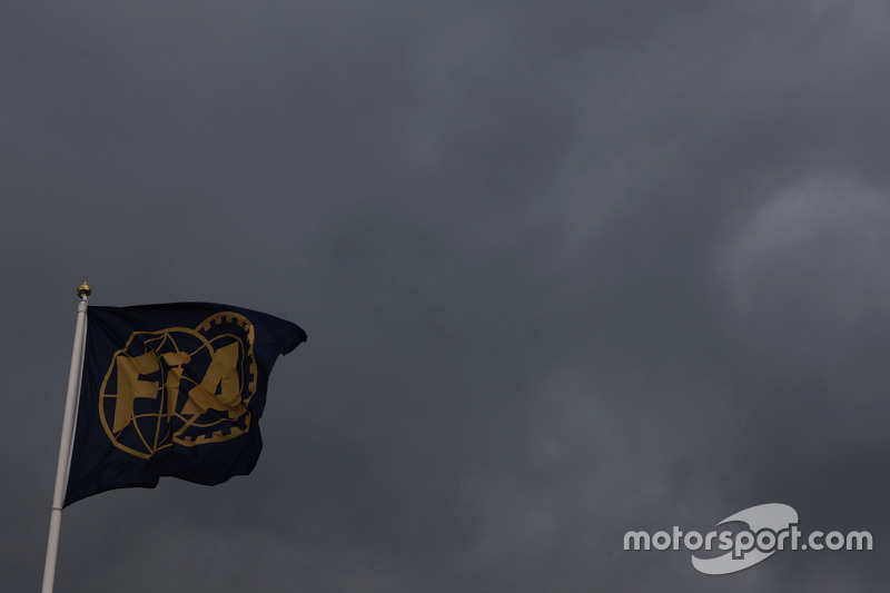 Dark clouds and the FIA flag.