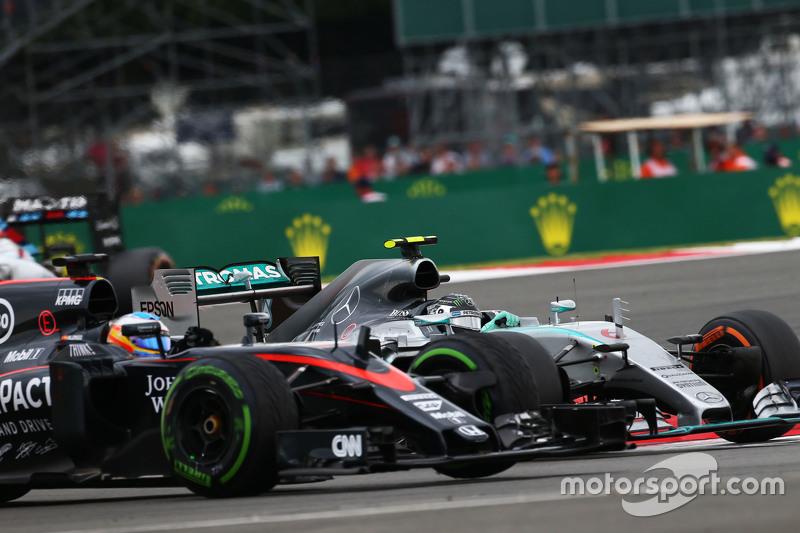 Fernando Alonso, McLaren MP4-30 and Nico Rosberg, Mercedes AMG F1 W06.