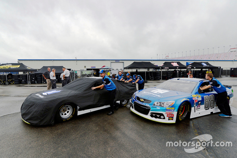Hendrick Motorsports crew members push Dale Earnhardt's car