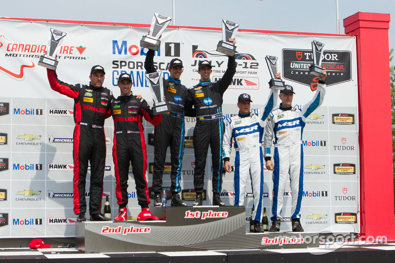 Prototype podium: Race winners #10 Wayne Taylor Racing Corvette DP: Ricky Taylor, Jordan Taylor, second place #31 Action Express Racing Corvette DP: Eric Curran, Dane Cameron and third place #60 Michael Shank Racing with Curb/Agajanian Ligier JS P2 Honda: John Pew, Oswaldo Negri Jr.