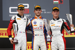 Luca Ghiotto, Trident celebrates his win on the podium with second place Esteban Ocon, ART Grand Prix and third place Marvin Kirchhofer, ART Grand Prix