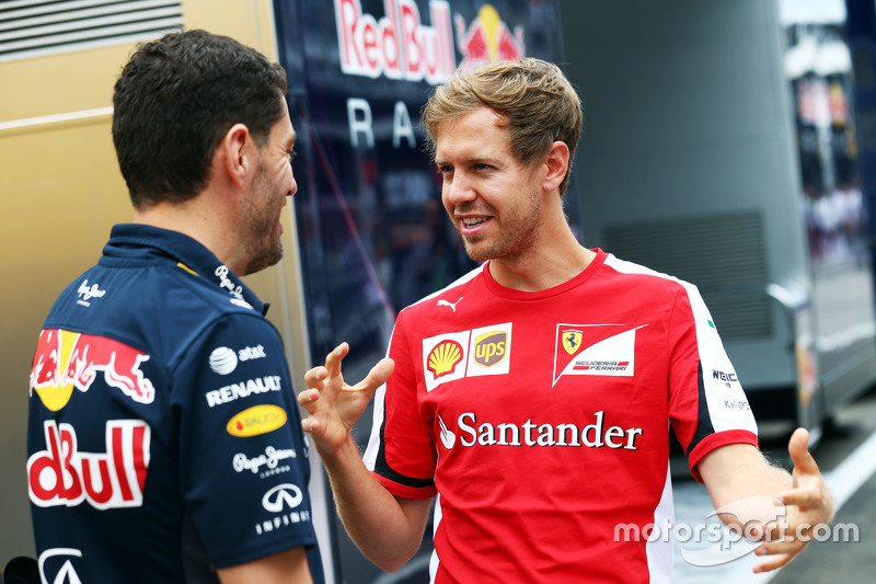 Sebastian Vettel, Ferrari bersama Guillaume Rocquelin, Red Bull Racing Head of Race Engineering