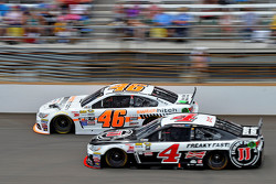 Michael Annett, HScott Motorsports Chevrolet and Kevin Harvick, Stewart-Haas Racing Chevrolet
