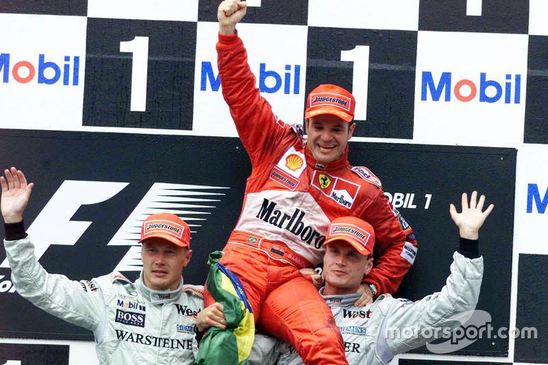 Podium: second place Mika Hakkinen, McLaren and winner Rubens Barrichello, Ferrari and third place David Coulthard, McLaren