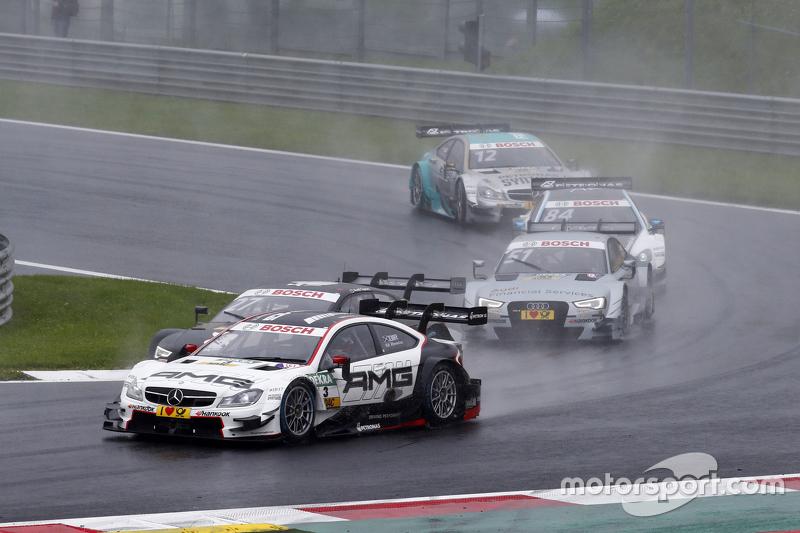 Paul di Resta, HWA AG Mercedes-AMG C63 DTM leads Nico Müller, Audi Sport Team Rosberg Audi RS 5 DTM