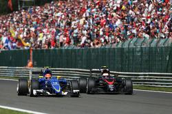 Felipe Nasr, Sauber C34 and Jenson Button, McLaren MP4-30 battle for position