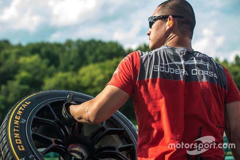 Scuderia Corsa crew member