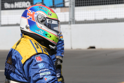 Andretti Autosport team member with a Justin Wilson helmet